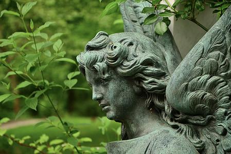 portrait photo of female angel concrete statue