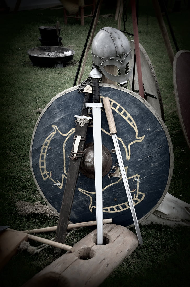 black handled sword with blue shield behind