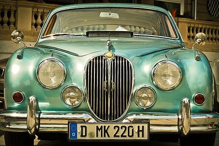 close-up photo of teal car