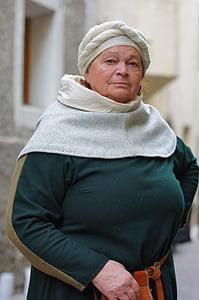 woman wearing green long-sleeved dress