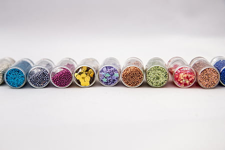 assorted-color bead containers