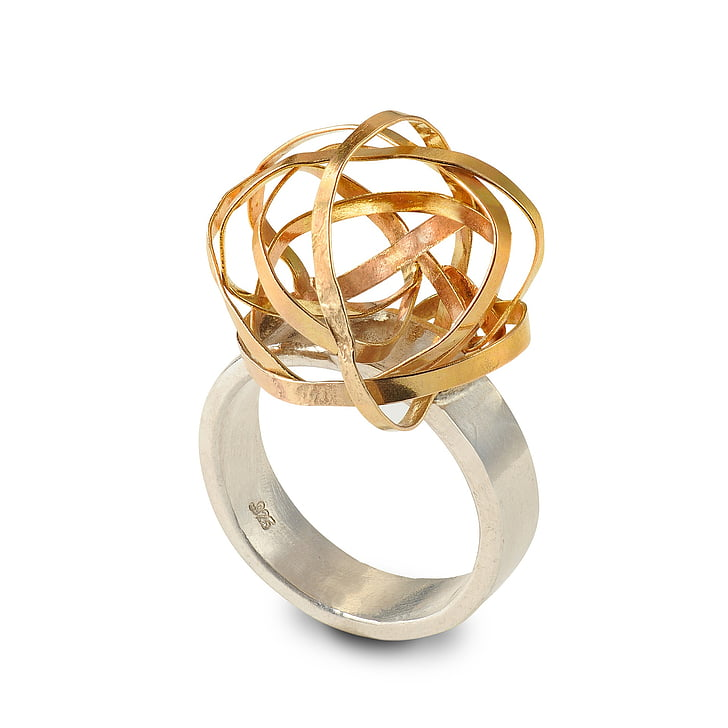 gold-colored ring with sphere