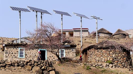 brown brick houses under solar panels
