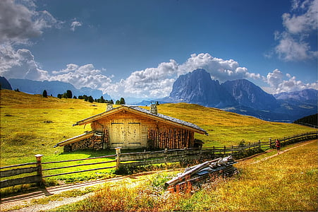 Cabin on the middle of grass field