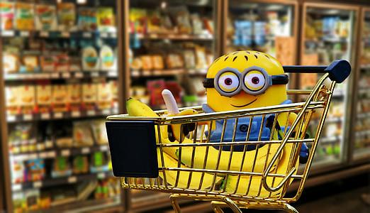 minion plush toy on gold shopping cart