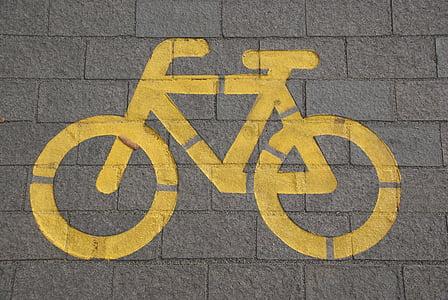 yellow bicycle lane signage