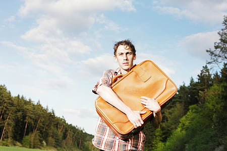 man holding leather bag