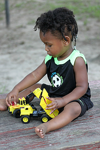 boy playing truck toy