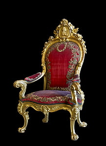 gold-colored frame red floral padded armchair
