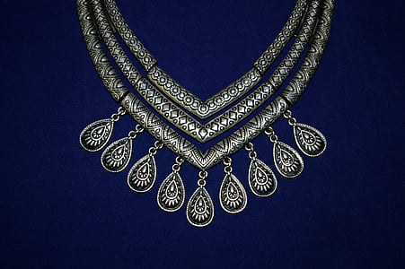 photo of silver-colored 3-layered bib necklace