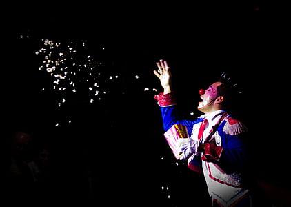 clown tossing popcorn