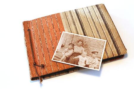 woman with three boys photo on photo album