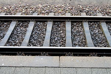 gray steel train rail