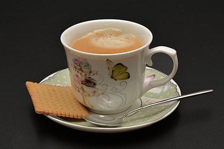 mug of coffee on saucer