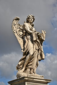 photo of man with wings statue
