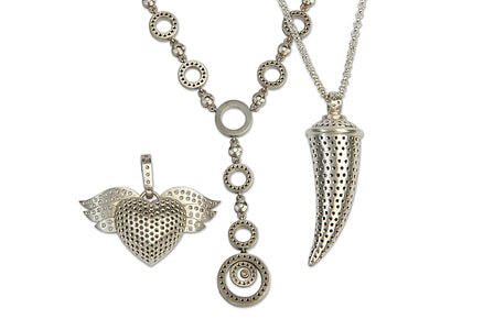 silver-colored chain necklace with heart pendant