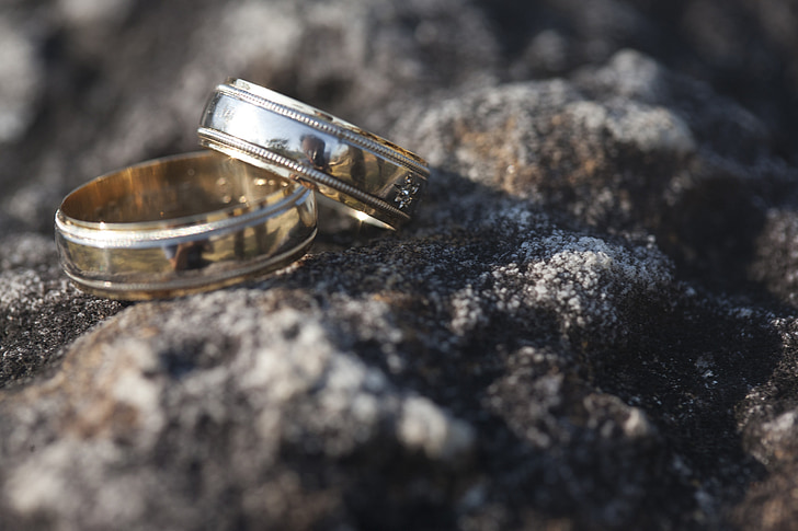 two silver-colored band rings