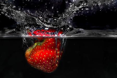 strawberry under water