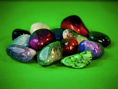 assorted color stones with green background