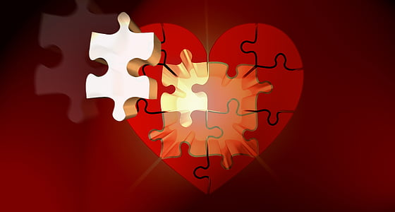 heart red and white puzzle on red surface