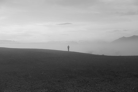 person standing on gray field
