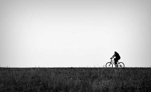 person riding on bicycle at road