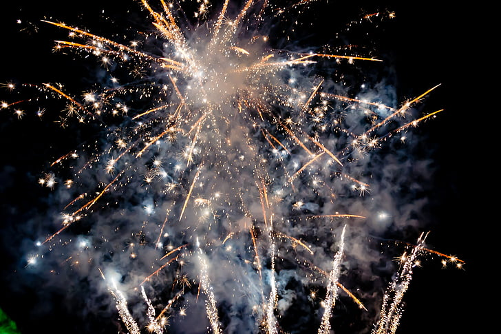 brown and white aerial fireworks photography during night time