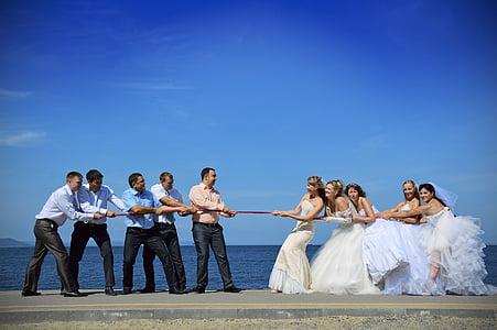 bride and groom acting playing tug of war