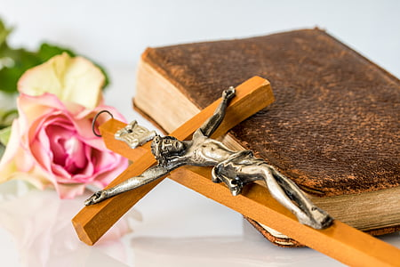 crucifix and bible on table