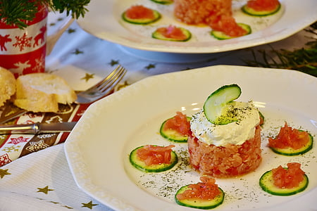 sliced cucumbers with cream on white ceramic plate