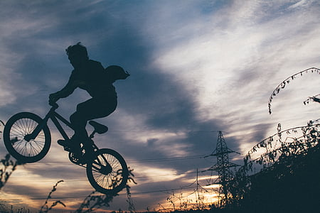 man riding on BMX bike silhouette