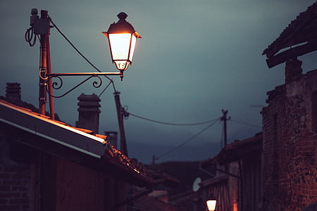 photo of lighted lamp post