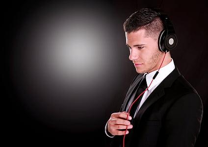 man wearing black headphones