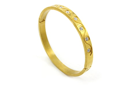 gold-colored clear gemstone ring