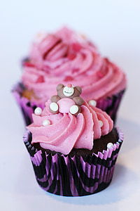 selective focus photography of pink and black cupcake