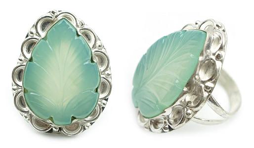 two green leaf gemstone rings o white background