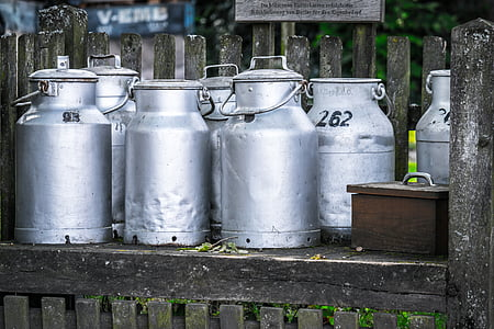 close-up photography of several assorted gray stainless steel containers