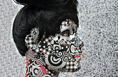 woman with black and white face painting