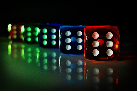 selective focus photography of five dices reflecting on surface