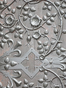 beige wooden board with gray petaled flower embossed print