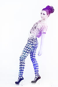 woman wearing pink and gray striped crop top and black and white houndstooth pants