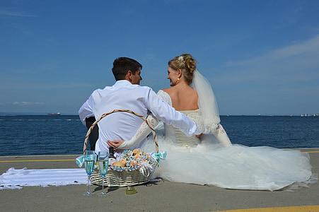 woman wearing white wedding gown and man wearing white dress shirt
