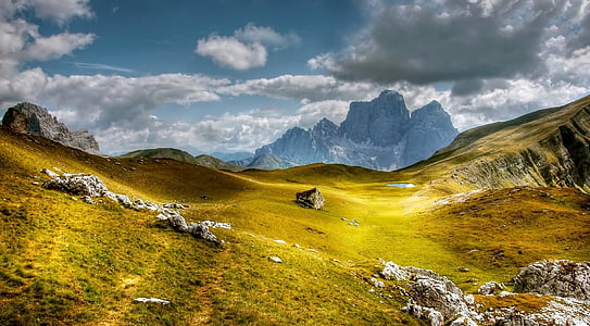 photo of green mountain during daytime