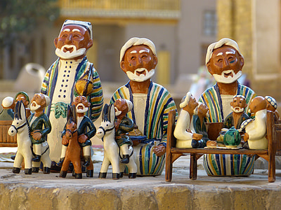 brown-and-white ceramic figurines