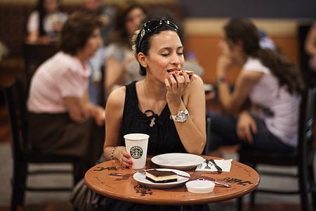 woman wearing black sleeveless top