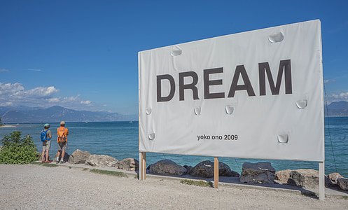 Dream signboard near body of water