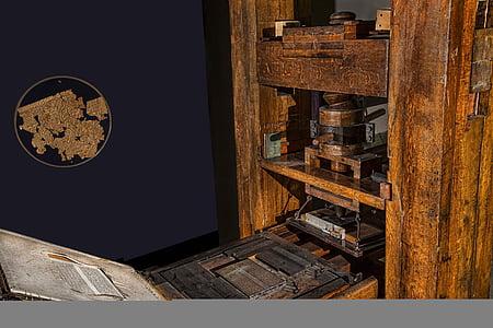 rectangular brown wooden machine