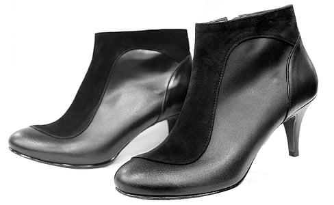 pair of women's black leather kitten heeled booties
