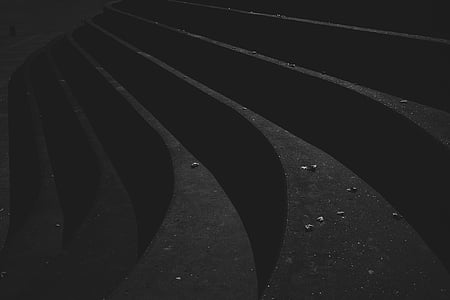 grayscale photography of black concrete stairs