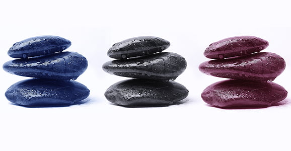 three assorted-color stackable stones